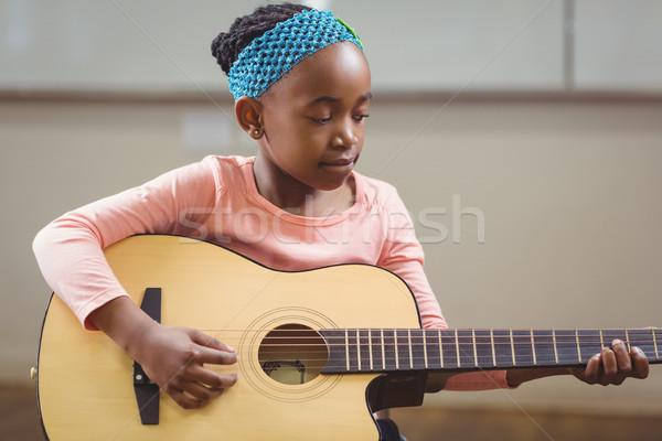 Odaklı oynama gitar sınıf okul mutlu Stok fotoğraf © wavebreak_media