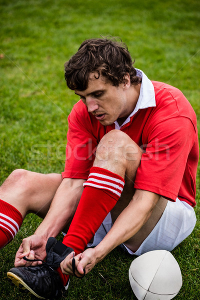 Rugby player tying his shoelace Stock photo © wavebreak_media