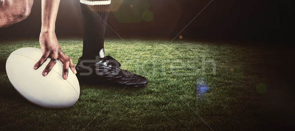 Composite image of low section of athlete holding ball while run Stock photo © wavebreak_media