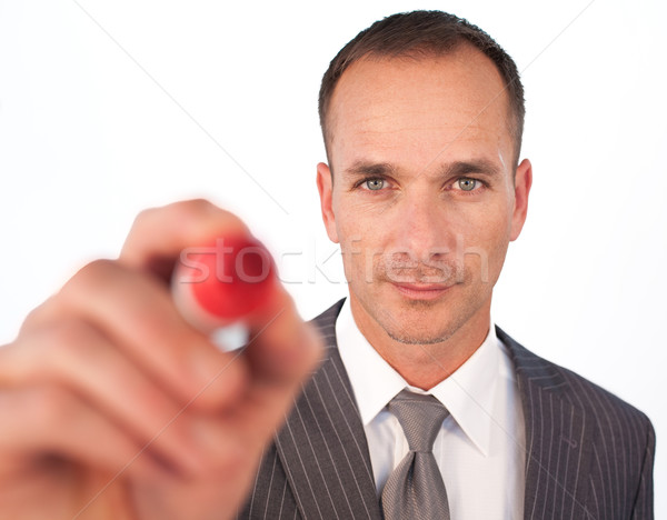 Businessman using a red felt-tip pen Stock photo © wavebreak_media