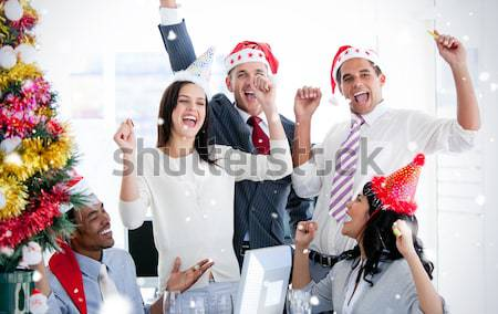 Business team punching the air to celebrate christmas  Stock photo © wavebreak_media