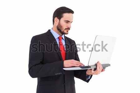 Self-assured businessman consulting his agenda  Stock photo © wavebreak_media