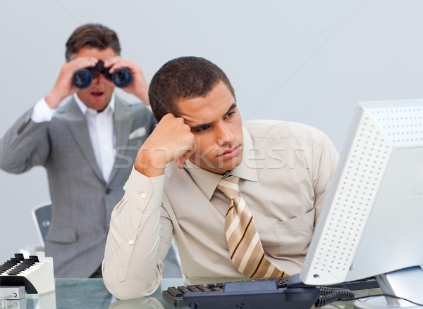 Stock photo: Young businessman getting bored and his manager looking through binoculars