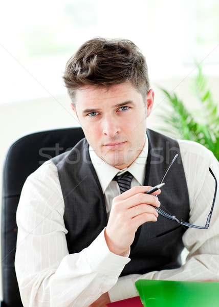 Portait of a self-assured businessman holding glasses  sitting in his office Stock photo © wavebreak_media