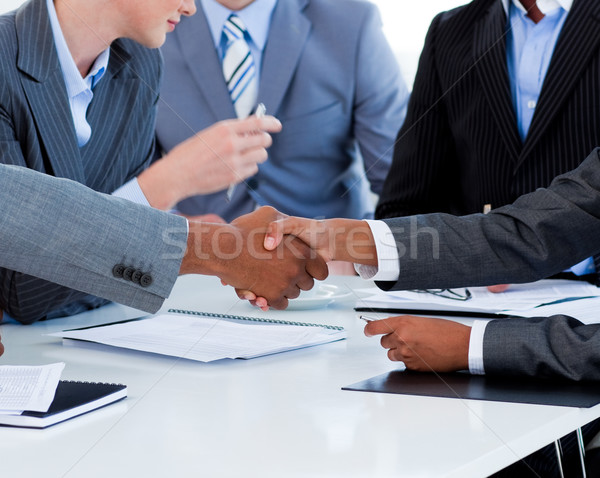 Stock photo: Close-up of business people greeting each other in a meeting