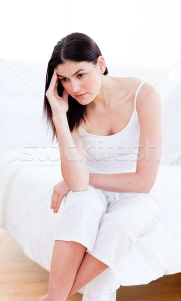 Portrait of a unhappy woman sitting on bed Stock photo © wavebreak_media