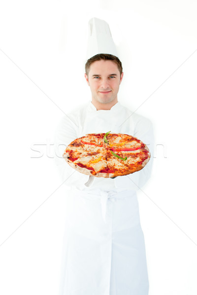 Young male cook smell at pizza with closed eyes against white background Stock photo © wavebreak_media