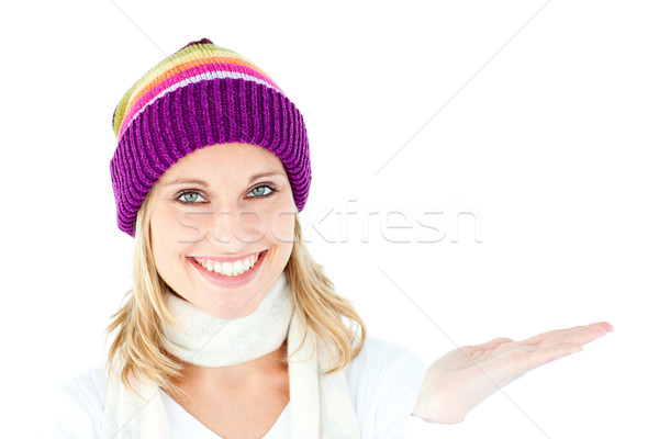 Smiling young woman presenting looking at the camera against white background Stock photo © wavebreak_media
