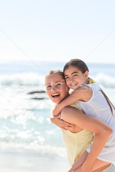 Mother having daughter a piggyback at the beach Stock photo © wavebreak_media