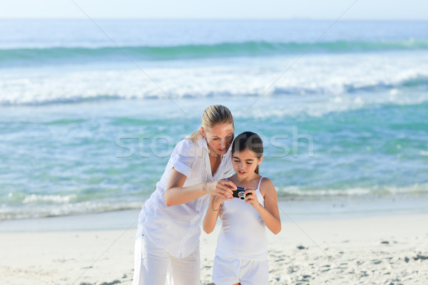 Little girl taking a photo of herself and her mother Stock photo © wavebreak_media