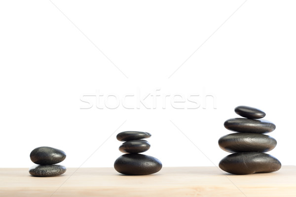 Spaced out and piled up pebbles on a white and brown background Stock photo © wavebreak_media