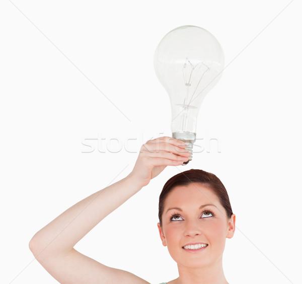 Kadın ampul ayakta beyaz Stok fotoğraf © wavebreak_media