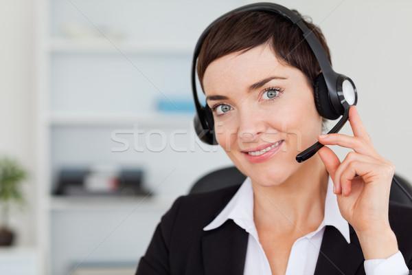 Sorridente secretário chamada fone escritório Foto stock © wavebreak_media