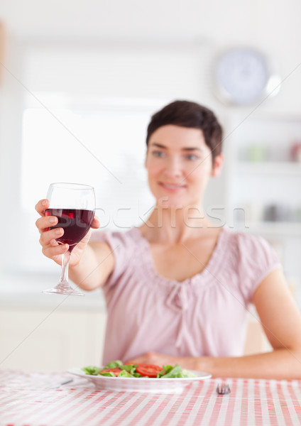 Charming brunette Woman toasting with wine in a kitchen Stock photo © wavebreak_media