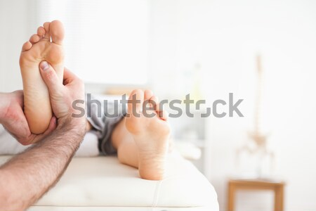 Male masseur doing a reflexology massage in a room Stock photo © wavebreak_media