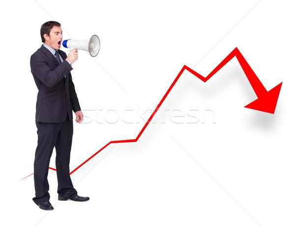Unsuccessful businessman using a megaphone with a curve going down Stock photo © wavebreak_media