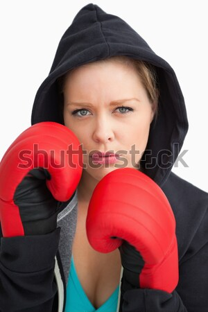 Female boxer with hoodie on in defensive stance against a white background Stock photo © wavebreak_media