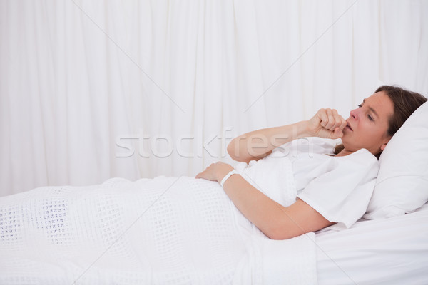 Side view of couching patient lying in bed Stock photo © wavebreak_media