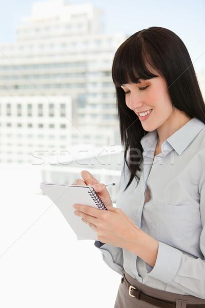 Stockfoto: Vrouw · kantoor · schrijven · beneden · merkt · nota