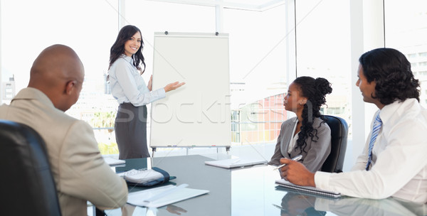 Stock photo: Three serious employees earnestly listening to a presentation