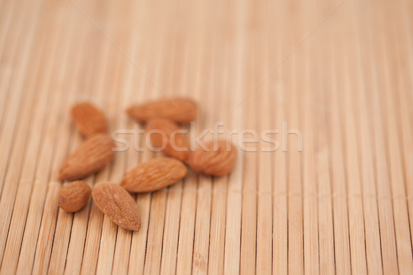 Eight almonds laid out together Stock photo © wavebreak_media