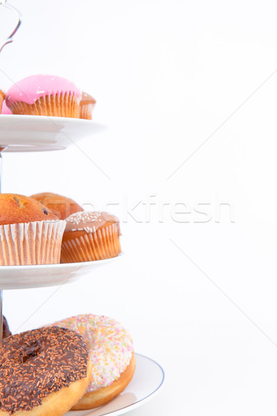 Close up of many cakes placed on three white plates against a white background Stock photo © wavebreak_media
