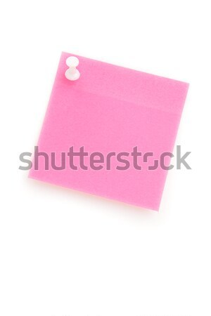 Pink adhesive note hanging with a pushpin against a white background Stock photo © wavebreak_media