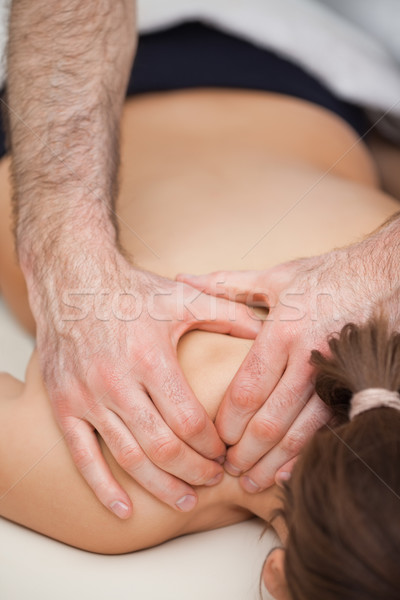 Osteopath pressing the shoulders of his patient while using his two hands indoors Stock photo © wavebreak_media