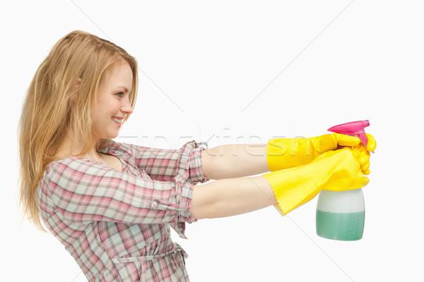 Nő tart spray üveg mosolyog fehér Stock fotó © wavebreak_media
