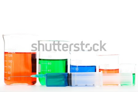 Five beakers in different size against a white background Stock photo © wavebreak_media
