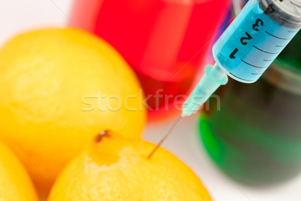 Syringe injecting liquid into a lemon against a white background Stock photo © wavebreak_media