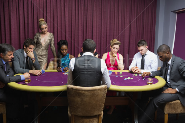 People sitting at the poker table playing cards in casino Stock photo © wavebreak_media