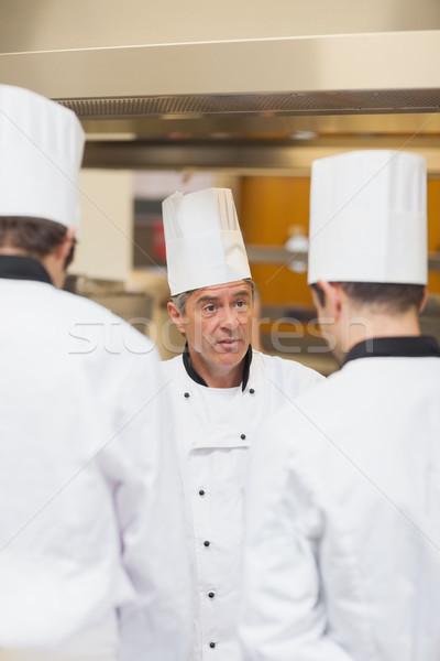 Head chef scolding employees in the kitchen Stock photo © wavebreak_media