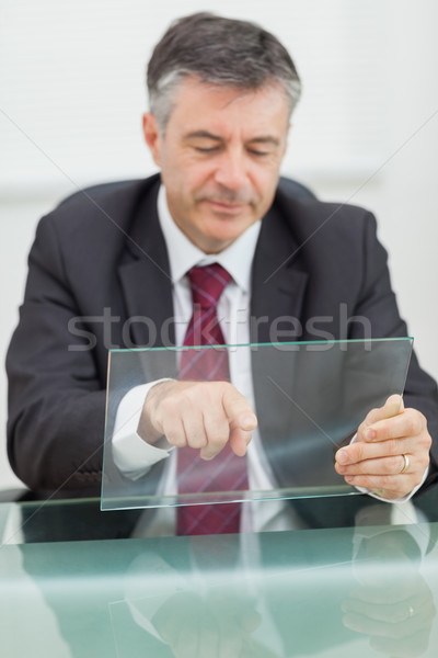 Business man scrolling on a virtual screen in his office Stock photo © wavebreak_media