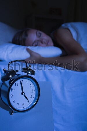 Upset woman putting pillows on her ears Stock photo © wavebreak_media