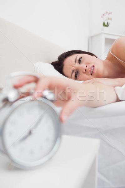 Nő ágy kéz ébresztőóra közelkép ház Stock fotó © wavebreak_media