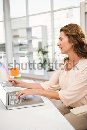 Side view of young woman using laptop Stock photo © wavebreak_media