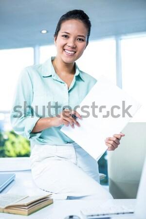 Doctor giving you prescription in front of computer at clinic de Stock photo © wavebreak_media