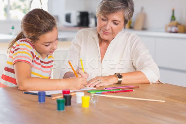 Kislány rajz nagymama fókuszált konyha papír Stock fotó © wavebreak_media