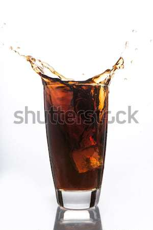 Soda and alcohol filling a glass with ice cube Stock photo © wavebreak_media