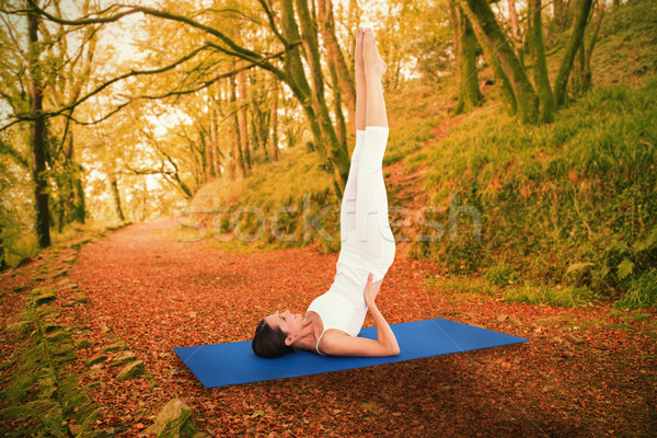 Composite image of fit woman stretching body in fitness studio Stock photo © wavebreak_media