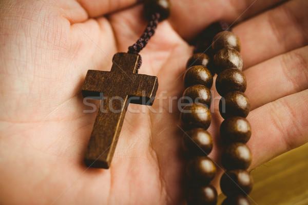 Hand holding wooden rosary beads Stock photo © wavebreak_media