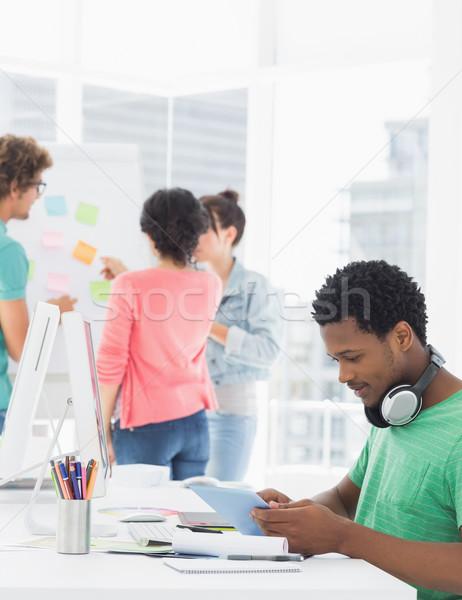 Homme numérique comprimé collègues derrière Photo stock © wavebreak_media