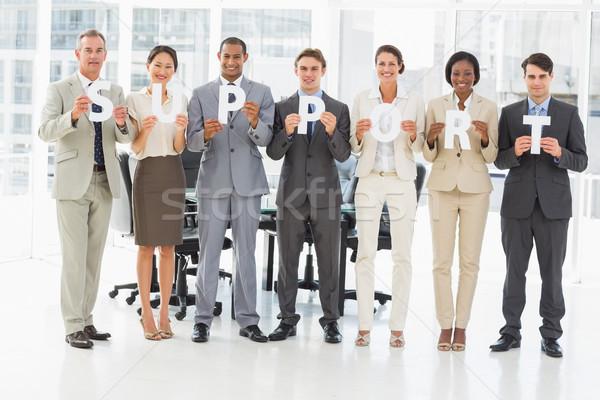 счастливым бизнес-команды письма правописание поддержки Сток-фото © wavebreak_media