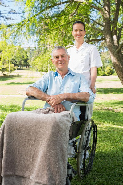 Woman with her father sitting in wheel chair at park Stock photo © wavebreak_media