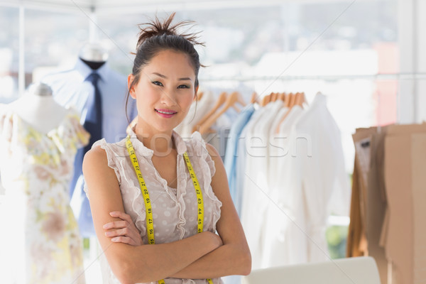 Portrait of a beautiful female fashion designer with rack of clo Stock photo © wavebreak_media
