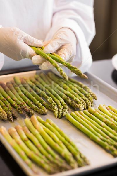 Hands with fresh asparagus in kitchen Stock photo © wavebreak_media