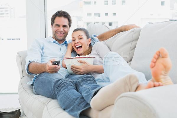 Para oglądania funny film sofa puchar Zdjęcia stock © wavebreak_media