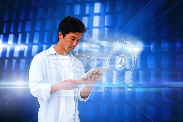 Przypadkowy człowiek tabletka interfejs digital composite niebieski Zdjęcia stock © wavebreak_media