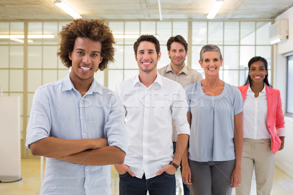 Group of business people being cheerful and smiling at camera Stock photo © wavebreak_media